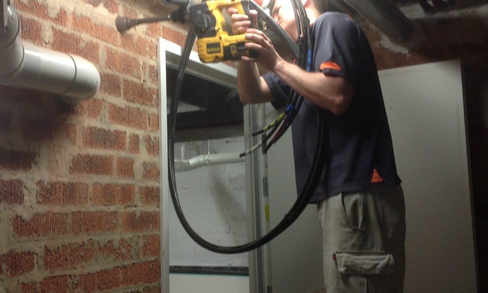 Drilling a big hole in a brick wall